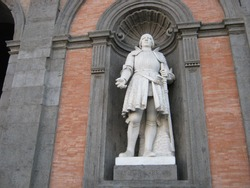 Statue representing King Alfonso V of Aragon located on the facade of the Royal Palace in Piazza del Plebiscito, Naples, Campania, Italy. King Alfonso V said the magnanimous.