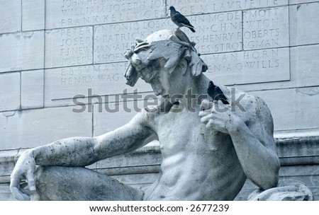 Statue with birds atop in Central Park in New York City.
