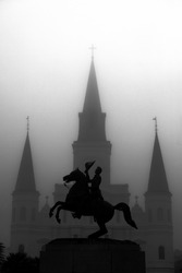Statue with Church in background in New Orleans, Louisiana