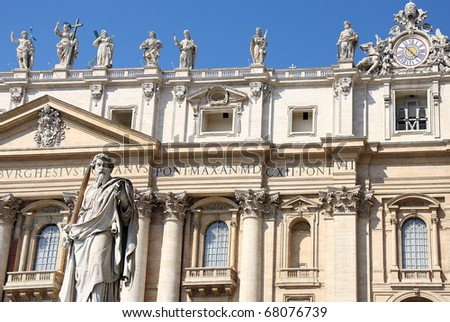 Statue with sword against St.Peter Basilica