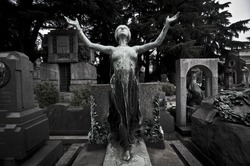 statues at the cemetery frightening and bleak