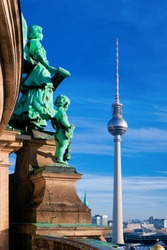 Statues of Berlin Cathedral and Fernsehturm TV tower in German City centre in Berlin in Germany in Europe. Building architecture of Berliner Dom. Details of exterior. Religion, Tourism and holidays