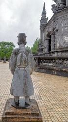 statues of Mandarin soldiers Khai Dinh Royal Tomb in Hue, Vietnam