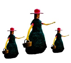 Statues of three girls wearing caps and carrying baskets