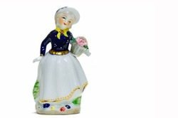 statuette depicting a woman with a basket of flowers. painted porcelain. collectibles. Swap meet. Antiques, art.