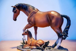Statuette of a horse and a lying foal, indoor