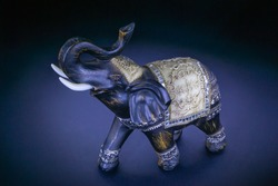 Statuette of an elephant on a dark background