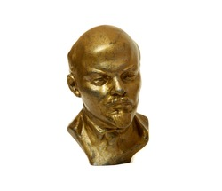 Statuette of Lenin, leader of russian proletarian October revolution in 1917. Isolated bronze bust on white background