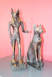 statuette of the god Anubis and a sacred cat. Egyptian mythology.