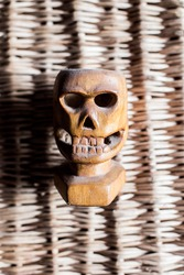 statuette skull carved from wood