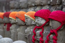 Statuettes of Buddha disciples in the hats  in Daisho-in Temple Miyajima, Japan