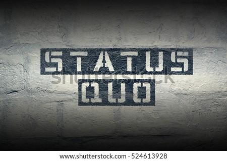 status quo stencil print on the grunge white brick wall #524613928