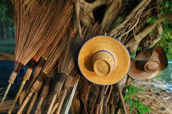 Staw hat duo and the army of coconut leaf stick broom.