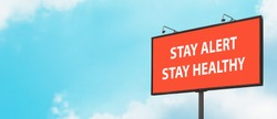 Stay Alert Stay Healthy warning sign on blue sky background. Large billboard with the message text. Staying alert after end of coronavirus lockdown restrictions, Covid-19 quarantine concept