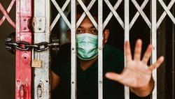 Stay at home or Quarantined man.Coronavirus covid-19 infected patient in coronavirus covid 19 quarantine home.Asian man quarantine 15 day lockdown at home.coronavirus outbreak control.Stop and control