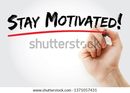 Stay motivated! text with marker, concept background