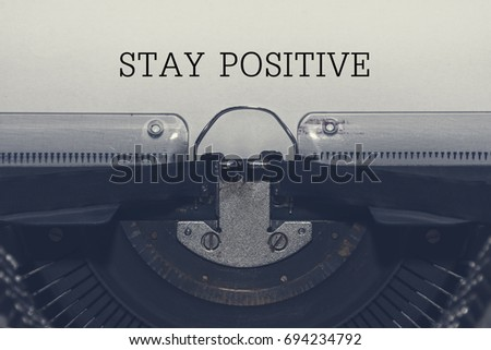 Stay positive, inspirational quote on vintage paper typewriter in vintage color.  #694234792