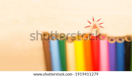 Stay sharp and stand out concept, Sharp tip pencil stand out from the others blur pencils on wood background Stockfoto ©