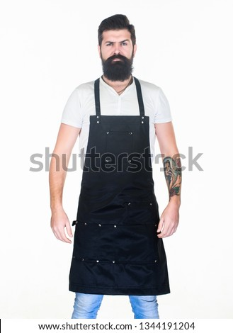 Staying clean and comfortable with chef apron. Bearded man cook in kitchen apron. Cook with long beard wearing bib apron. Master cook in cooking apron with pockets. Grill cook isolated on white.