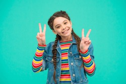 Staying cool and fabulous. Happy child show v signs blue background. Little girl with cool look. Fashion trends. Casual style. Cool and trendy clothes for kids. Beauty salon.