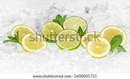 Staying healty. Healthy lifestyle. Lemon, Green Lemon and mint with crushed ice / ices cubes. Lemon ring. Ice background. Healty 2020. Health 2020
