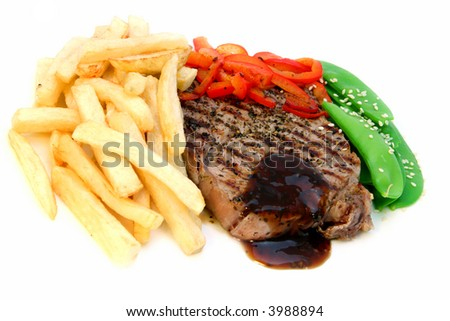 Steak and chips ~ beef fillet steak with home-made french-fries, red capsicum and snow peas. - stock photo