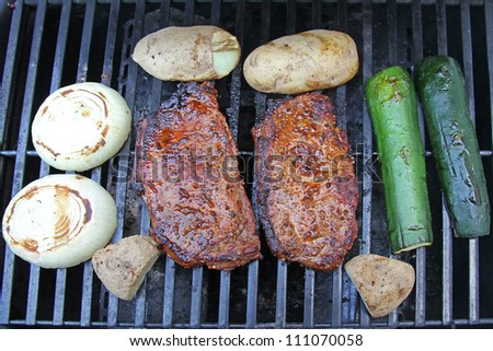 Steak and Fresh Veggies cooked and still sitting on a gas grill