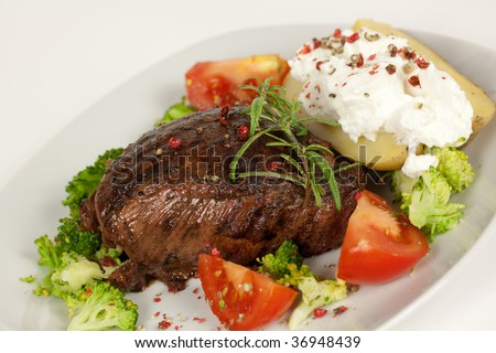 Steak dinner , Fillet Mignon- juicy grilled, pepper steak