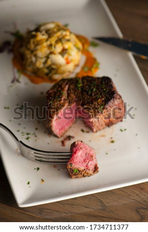Steak dinner or surf n' turf. Steakhouse entree served with wedge salad and lobster. Grass-fed skirt steak, grilled to a medium rare, served w/ side dishes. Classic American steakhouse favorite.