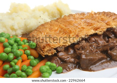 Steak pie with mashed potato and vegetables