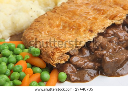Steak pie with mashed potato carrots & peas