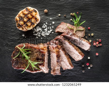 Steak Ribeye with spices on the graphite tray.