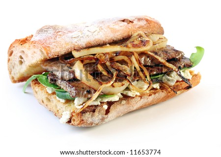 Steak sandwich.  Beef steak on a toasted baguette bread roll, with goat's cheese, spinach, and grilled onion.  Delicious!