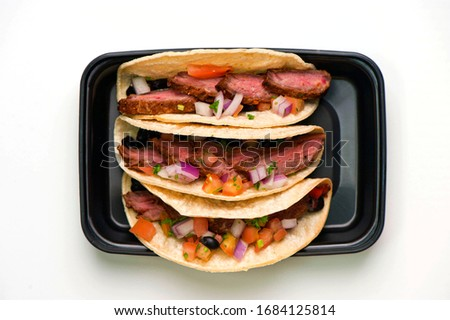 Steak tacos. Grass-fed skirt steak, grilled to a medium rare and served with a garlic herb butter sauce and paired with roasted potatoes and Brussels sprouts. Classic American steakhouse favorite.