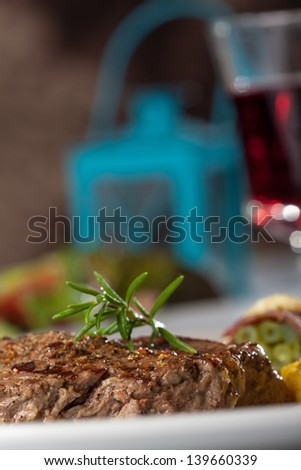 steak with a rosemary leaf