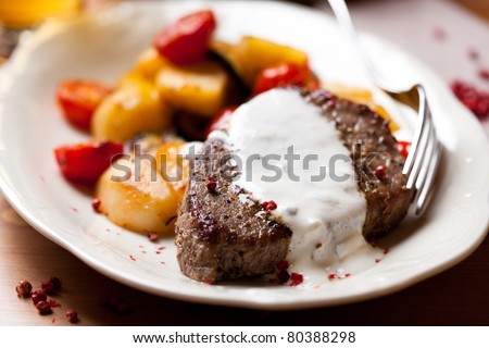 Steak with baked vegetables and sauce