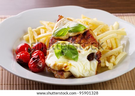Steak with cheese and french fries