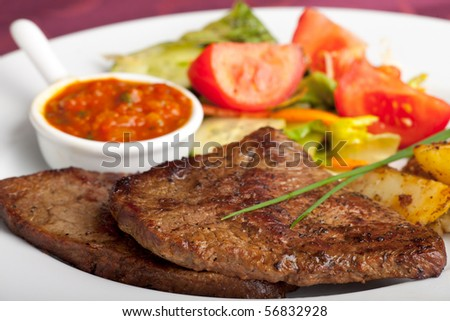 steak with ketchup and potatoes
