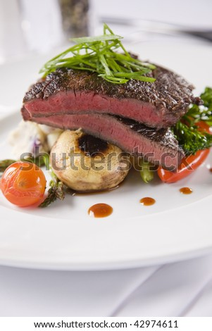 Steak with mushrooms and potato bake