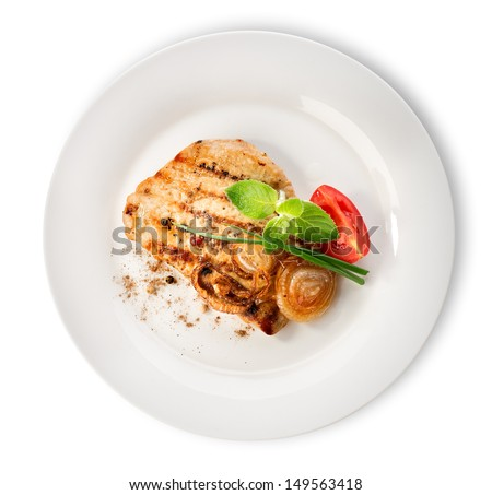 Steak with tomatoes in a white plate isolated #149563418