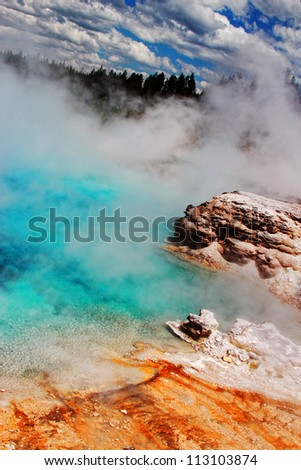 Steam and wind create an otherworldly atmosphere at one of the many geyser pools at Yellowstone National Park in Wyoming (Excelsior Geyser).