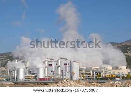 Steam coming out of a geothermal energy plant Stok fotoğraf ©