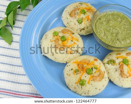 Steam cooked semolina cakes known as rava idli or idly.