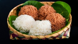 Steam cooked string hoppers. String hoppers or Idiappa is a traditional Sri Lankan and South Indian food which is made from rice flour that is squeezed to form thin noodles