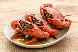 Steam crab in dish.