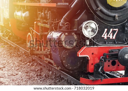 Steam engine train close up. Lamp and wheels of old fashioned  train details #718032019