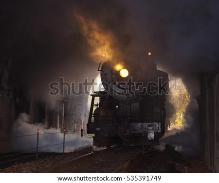 Steam locomotive enters tunnel