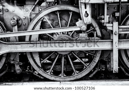 Steam locomotive wheels (black and white).