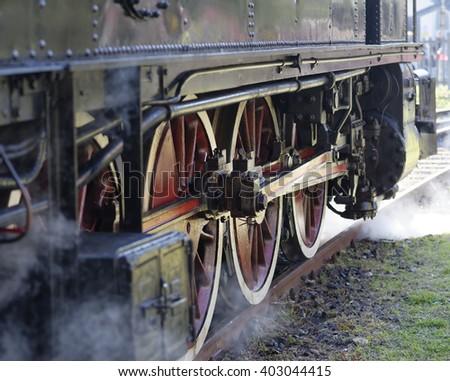 steam locomotive wheels close up in la speiza #403044415