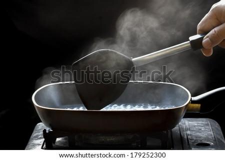 steam on pan in kitchen